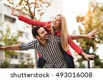 young happy couple is enjoying... | Shutterstock . vector #493016008