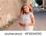beautiful young woman in white...   Shutterstock . vector #493034050