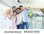 smiling happy family of four... | Shutterstock . vector #493037350