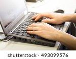 man's hands typing on laptop... | Shutterstock . vector #493099576