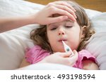 mother measuring temperature of ... | Shutterstock . vector #493198594