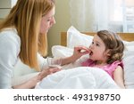 worried mother giving glass of...   Shutterstock . vector #493198750