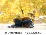 two mugs tied a warming scarf... | Shutterstock . vector #493222660