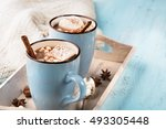 blue cup of hot chocolate drink ... | Shutterstock . vector #493305448