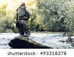 Small photo of Fly fisherman using flyfishing rod in beautiful river.