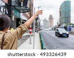 hailing a rideshare black car... | Shutterstock . vector #493326439