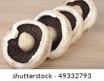 Large Mushrooms On On Wooden...