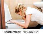 young woman voimiting in the... | Shutterstock . vector #493339714