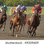 ARCADIA, CA - MAR 20: A field of thoroughbreds take the far turn and start down the homestretch at Santa Anita Park on March 20, 2010 in Arcadia, CA. - stock photo