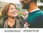 happy adult couple outdoors   Shutterstock . vector #493407478