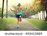 young fitness woman skipping...   Shutterstock . vector #493413889
