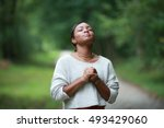 praying to god  posing african  ... | Shutterstock . vector #493429060