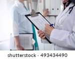 close up of a female doctor... | Shutterstock . vector #493434490