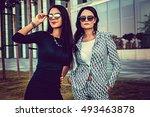 two fashionable women in... | Shutterstock . vector #493463878