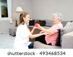 young physiotherapist nurse... | Shutterstock . vector #493468534