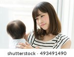 mother with her baby | Shutterstock . vector #493491490