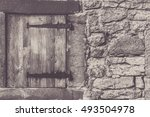 Small photo of Aged wooden trap door - Architectural frame with a weathered wooden trap door and the stone wall, from a traditional german house