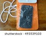 orange waterproof phone bag on... | Shutterstock . vector #493539103