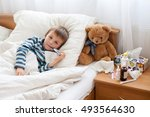 sick child boy lying in bed... | Shutterstock . vector #493564630
