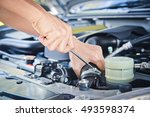 man check the car engine | Shutterstock . vector #493598374