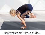 blonde woman doing yoga... | Shutterstock . vector #493651360
