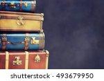 vintage pile ancient suitcases  | Shutterstock . vector #493679950