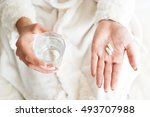 woman holding a glass of water... | Shutterstock . vector #493707988