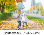the brother and the little... | Shutterstock . vector #493778590