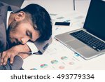tired businessman sleeping on... | Shutterstock . vector #493779334