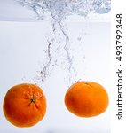 Small photo of orange fall under water