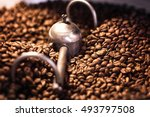 mixing roasted coffee closeup.... | Shutterstock . vector #493797508