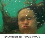 holding breath under water... | Shutterstock . vector #493849978