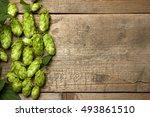 fresh green hops on a wooden... | Shutterstock . vector #493861510
