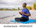 young black man wearing... | Shutterstock . vector #493941019