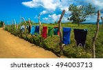 Stock photo colorful clothes hanging on clothesline to dry along a dirt road in a village catanduanes 494003713