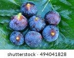 Seven Ripe Blue Figs On Big...
