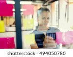 standing in front of glass wall ... | Shutterstock . vector #494050780