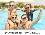 happy family in swimming pool... | Shutterstock . vector #494058178