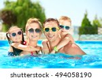 happy family in swimming pool... | Shutterstock . vector #494058190