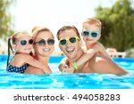 happy family in swimming pool... | Shutterstock . vector #494058283