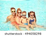 happy family in swimming pool... | Shutterstock . vector #494058298