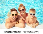 happy family in swimming pool... | Shutterstock . vector #494058394