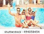 happy family near swimming pool ... | Shutterstock . vector #494058454