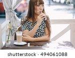 beautiful brunette smoke... | Shutterstock . vector #494061088