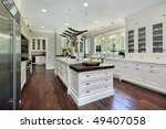 Stock photo kitchen in luxury home with white cabinetry 49407058