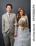 young asian groom and bride... | Shutterstock . vector #494088694