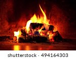 Close up shot of burning firewood in the fireplace. - stock photo