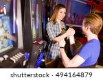 young couple playing at slot... | Shutterstock . vector #494164879