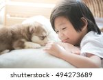 Stock photo cute asian child playing with siberian husky puppy 494273689