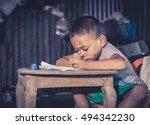Stock photo disadvantaged children doing homework 494342230